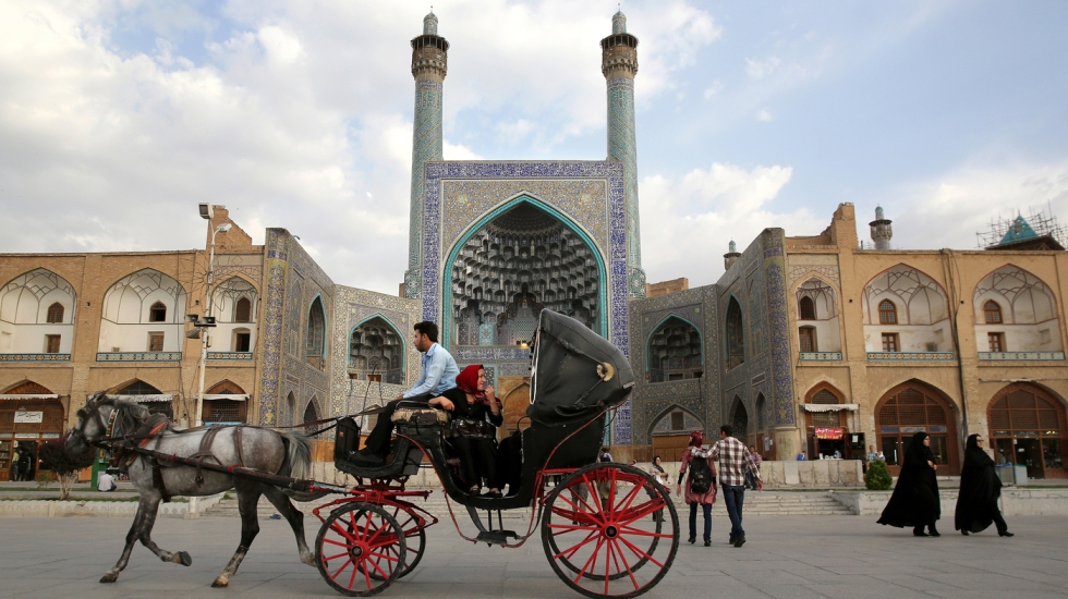 People ride a horse and carriage through Isfahan's central square in June 2014. With its immense mosques, picturesque bridges and ancient bazaar, the city is a virtual living museum of Iranian traditional culture and is a top tourist destination. After decades of difficult relations with the West, Iran now says it wants more foreign tourists, including Westerners